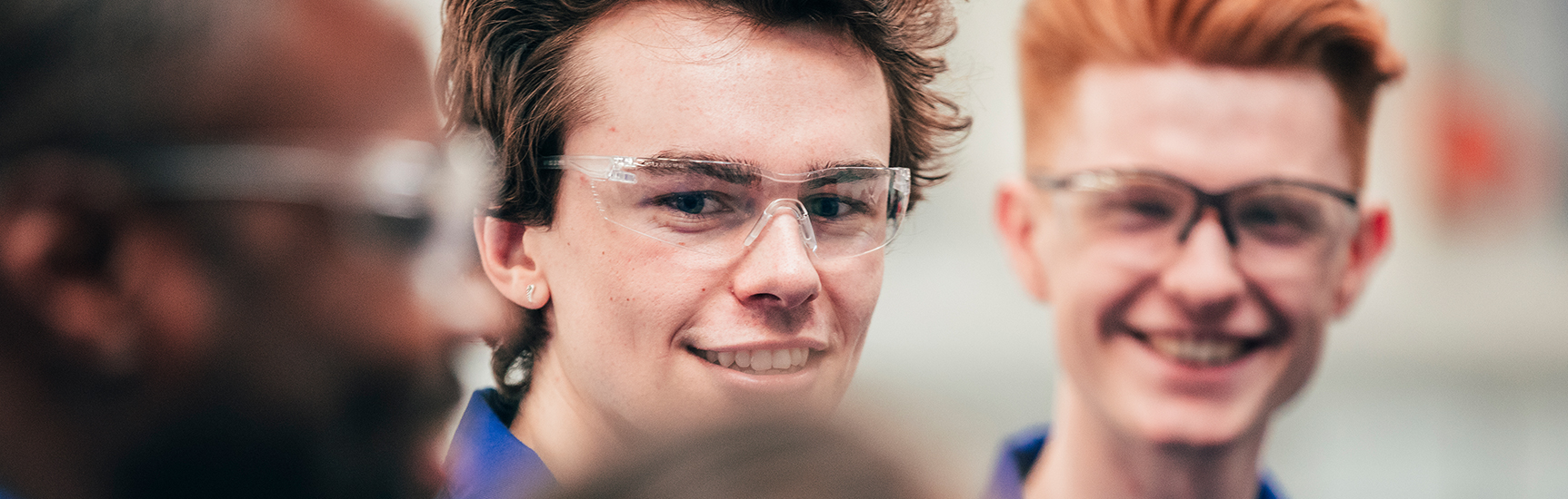 Happy apprentices in safety glasses